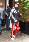 Kendall Jenner rocks Adidas jacket and snakeskin pants as she heads out in New York City