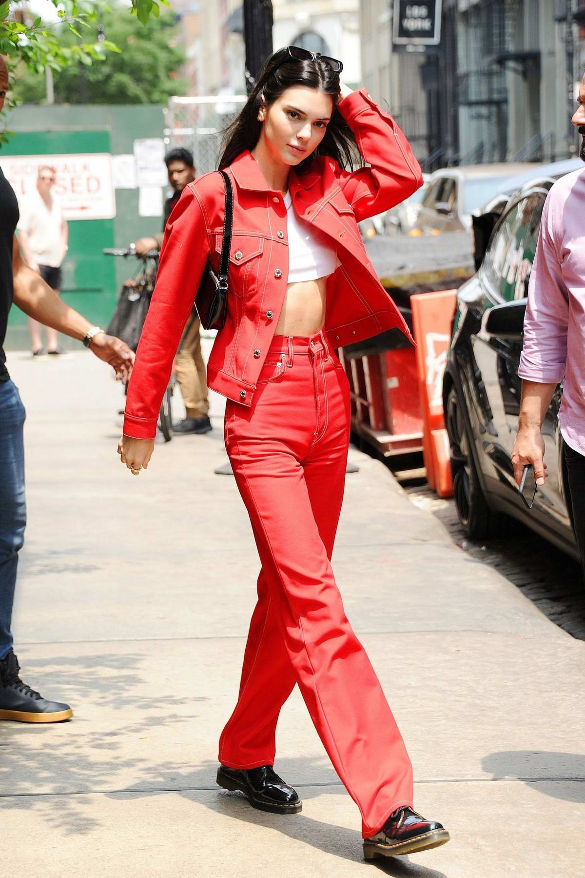 Kendall Jenner turns heads as she steps out in a matching red denim outfit in SoHo, New York City