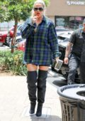 Khloe Kardashian rocks plaid shirt, shorts and thigh-high black boots while out shopping at Maxwell Dog in Studio City, Los Angeles