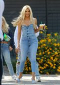 Khloe Kardashian seen wearing a denim outfit as she arrives at a studio in Los Angeles