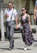 Kiernan Shipka and Charlie Oldman hold hands as they enjoy an afternoon walk along the Vancouver Seawall, Canada