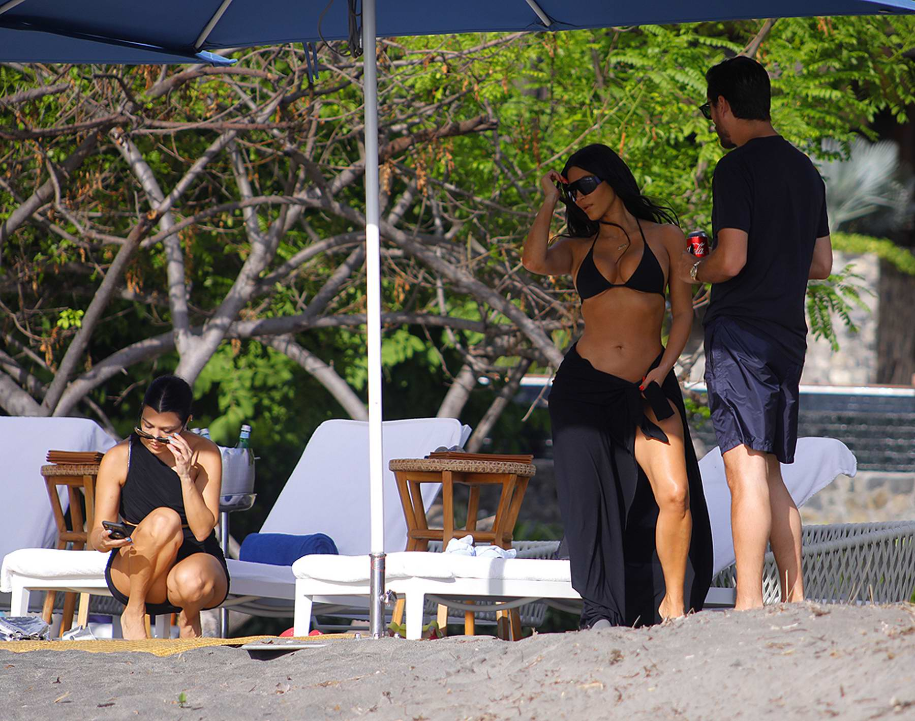 Kim and Kourtney Kardashian enjoy the beach with Scott Disck while on vacation in Puntarenas, Costa Rica