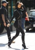 Kim Kardashian dons black form-fitting jumpsuit while out to lunch at Cafe Gratitude in Los Angeles