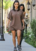 Kim Kardashian rocks an oversized Travis Scott tour t-shirt and Adidas Yeezys as she leaves a meeting in Calabasas, California