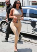 Kim Kardashian rocks skin-tight pants and silver tank top as she heads for lunch at Emilio's Trattoria in Encino, California