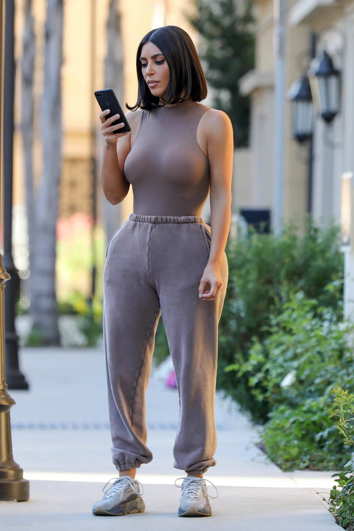 Kim Kardashian spotted in a form-fitting sleeveless top as she leaves her office in Calabasas, California