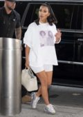 Kim Kardashian wore a white tee with matching legging shorts and yeezys as she arrives at JFK airport in New York City