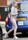 Kimberley Garner sports grey cropped jacket with mauve pink leggings and Nike trainers while out in London, UK