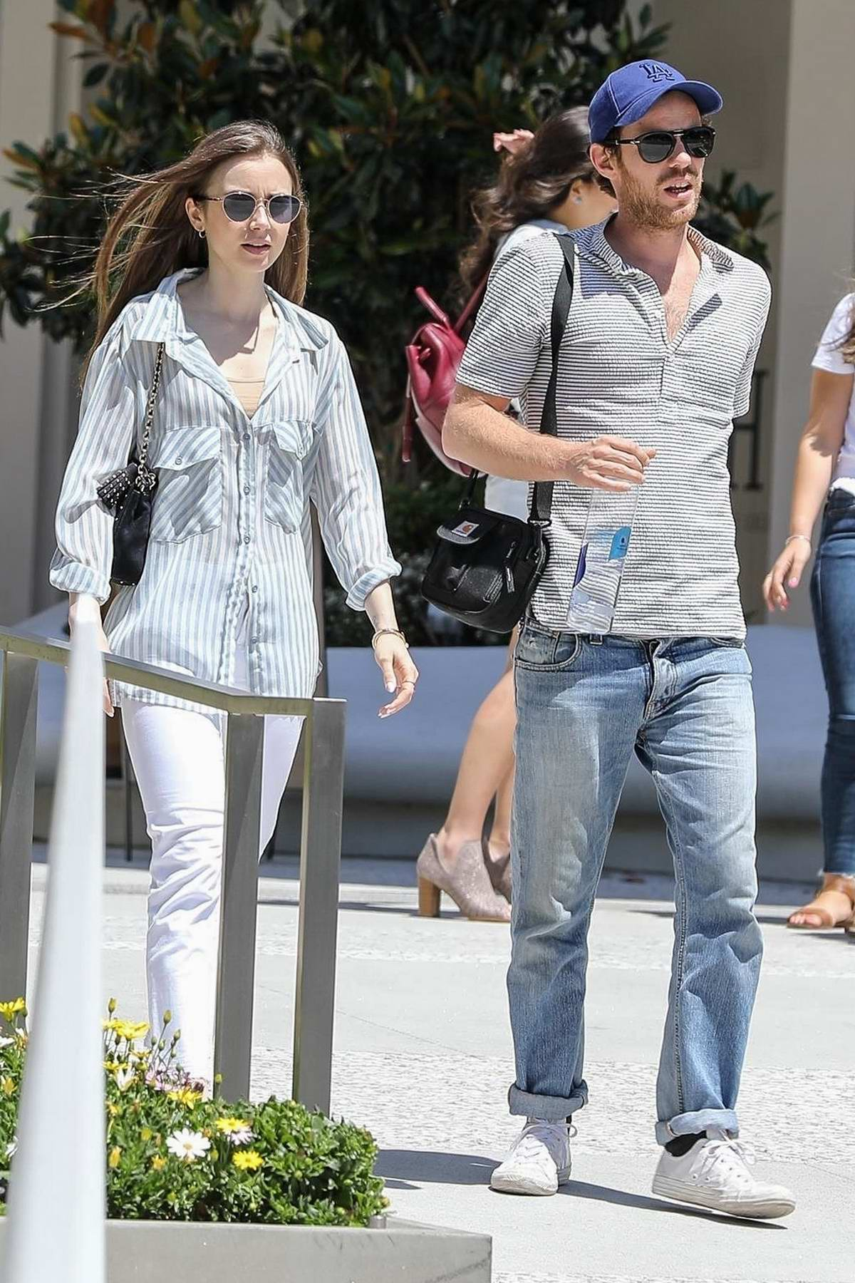 Lily Collins dressed casual while she grabs lunch with a friend in Los Angeles