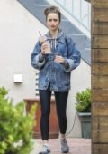 Lily Collins sips on an iced coffee as she leaves a massage studio in Westwood, California