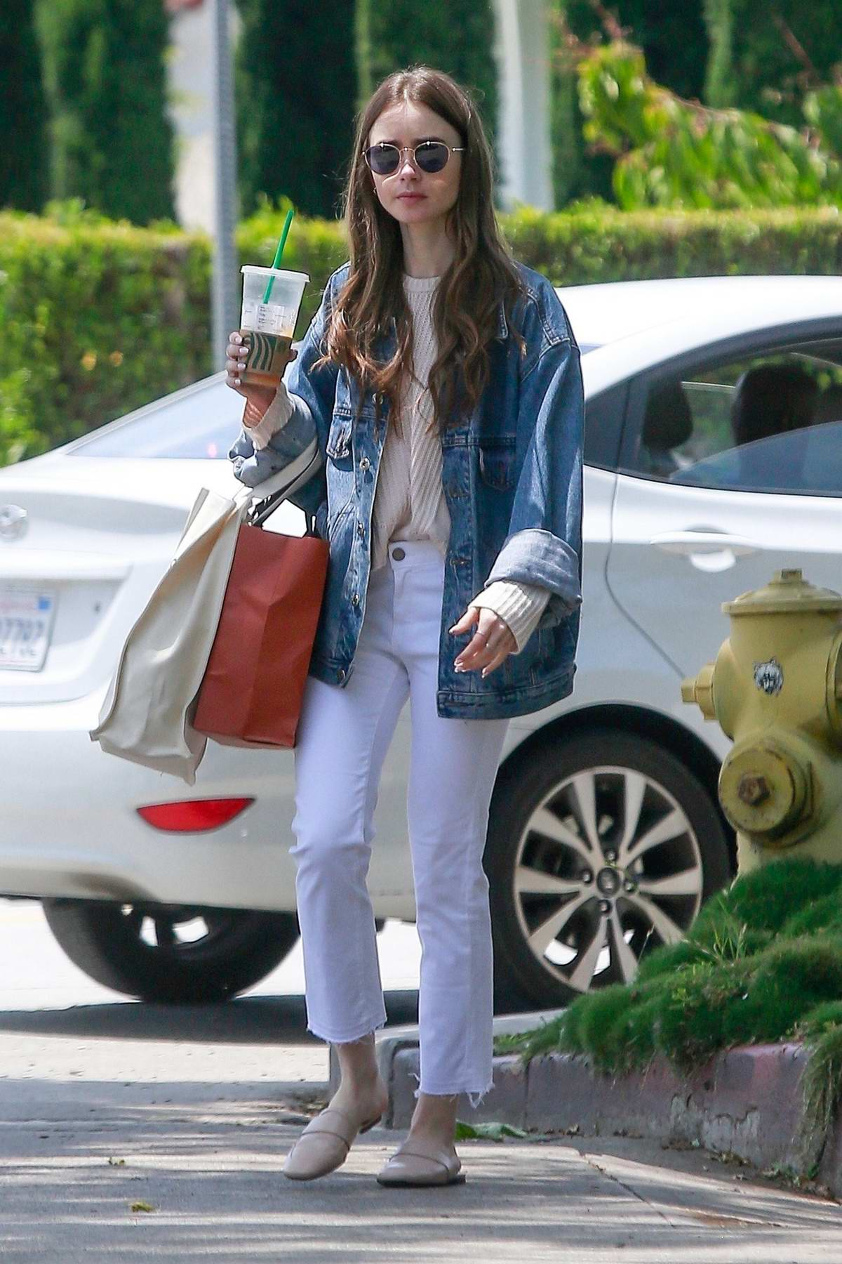 Lily Collins sports double denim as she steps out for some shopping in Los Angeles