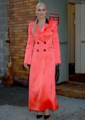 Lindsey Vonn stands out in bright orange while visiting 'The Daily Show with Trevor Noah' in New York City