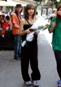 Lisa Manoban seen holding flowers as she steps out for a stroll around the Champs-Elysees in Paris, France