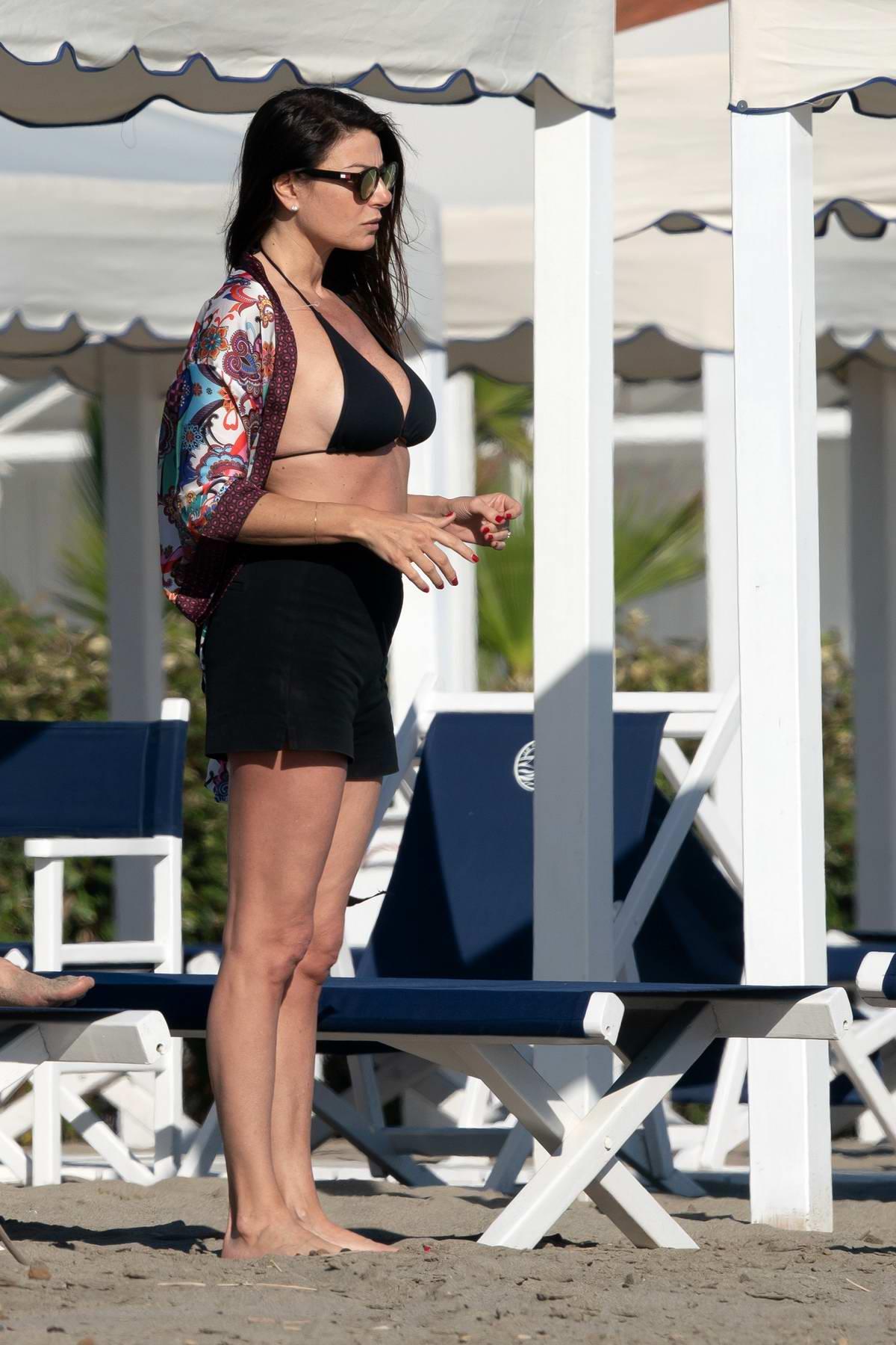 llaria D'Amico spotted in a black bikini while on the beach in Forte dei Marmi, Italy