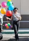 Lucy Hale gets surprised with balloons for her birthday as she leaves the Coffee Bean in Los Angeles