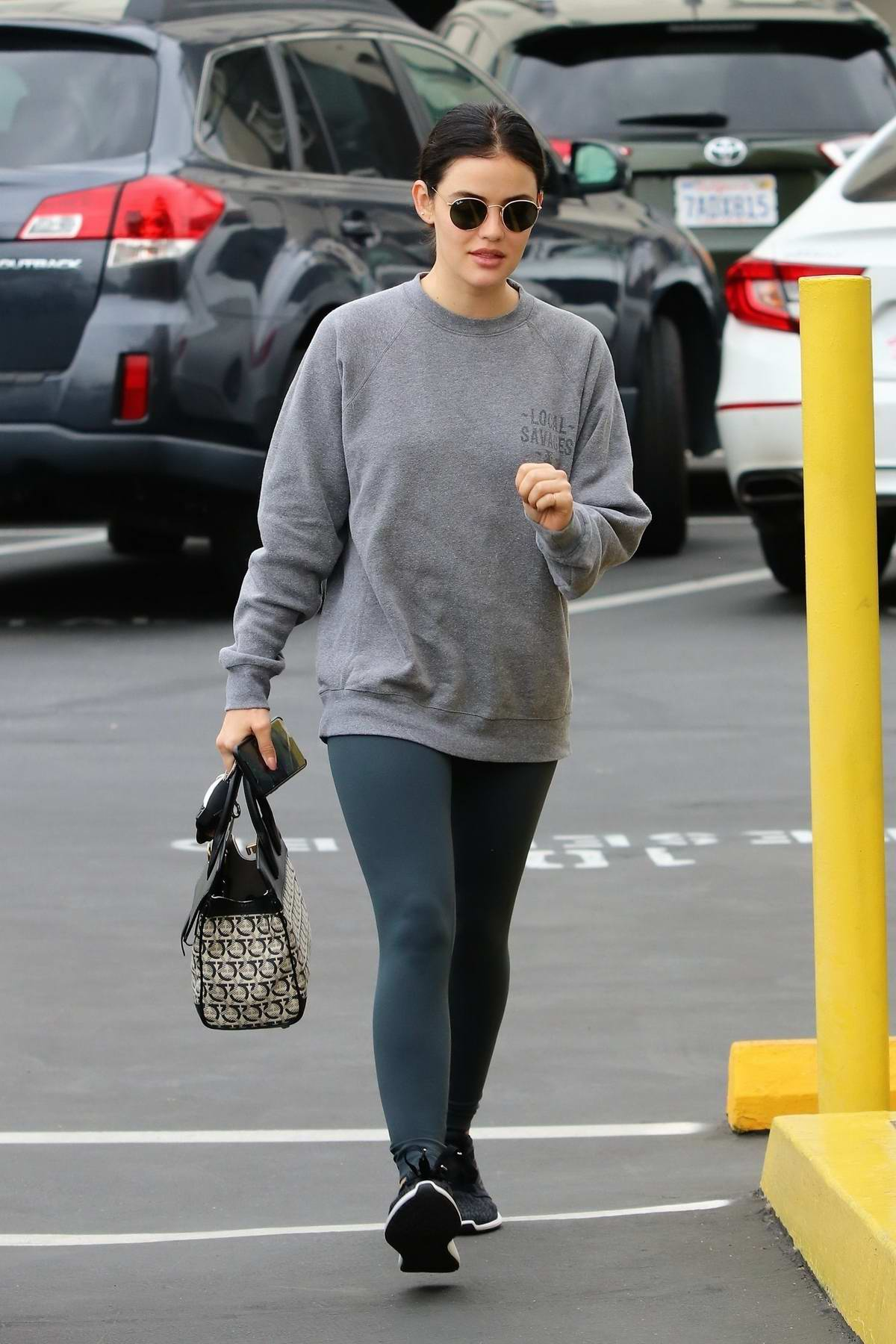 Lucy Hale keeps it casual with a sweatshirt and leggings while visiting a Dentist's Office in Toluca Lake, California
