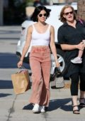 Lucy Hale looks cool in a white tank top and salmon-colored jeans while out on a shopping spree in Los Angeles
