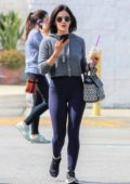 Lucy Hale rocks cropped grey hoodie and purple leggings as she steps out for an iced coffee in Los Angeles