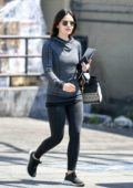 Lucy Hale sports grey hoodie and black leggings as she leaves the gym before running few errands in Studio City, Los Angeles