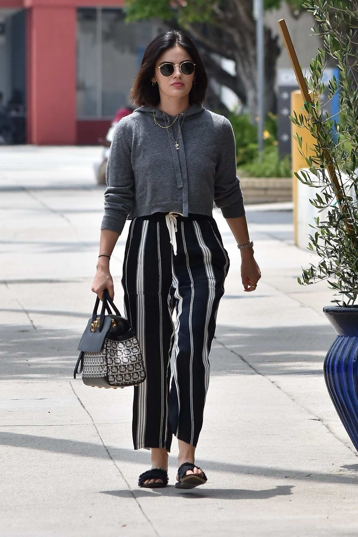 Lucy Hale wears striped pants, and cropped hoodie as she runs a few errands in Studio City, Los Angeles