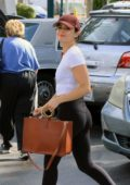 Lucy Hale wears white crop top and black leggings for some grocery shopping at Ralphs in Los Angeles