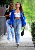Madison Beer rocks a white corset top and high-waist jeans while out with a friend in West Hollywood, Los Angeles