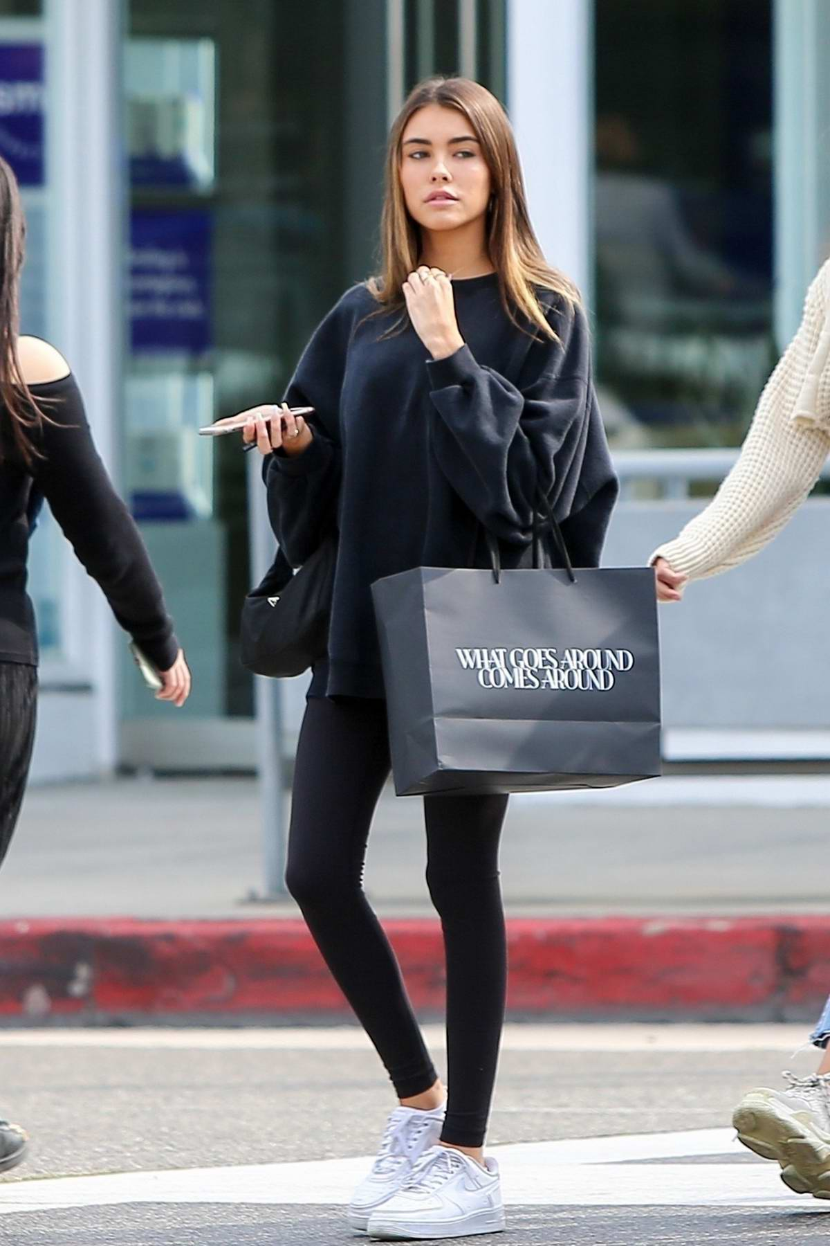 Madison Beer wears a black Nike sweatshirt and leggings while out shopping with friends in Beverly Hills, Los Angeles
