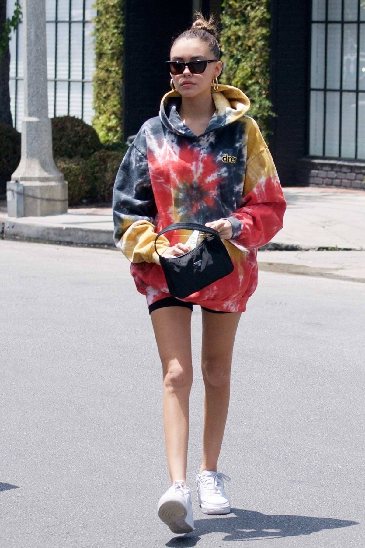 Madison Beer wears Justin Beiber's multicolored Drew hoodie during coffee run on Melrose Place in Los Angeles