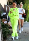 Madison Beer wears lime green sweatsuit as she steps out with her new kitten Rex in West Hollywood, Los Angeles
