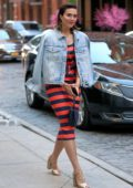 Mandy Moore seen wearing a red and blue striped dress as she leaves the Crosby Hotel in New York City