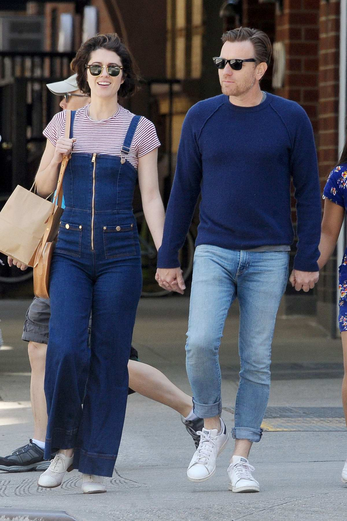 Mary Elizabeth Winstead and Ewan McGregor hold hands while on a stroll in New York City