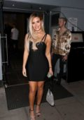 Megan Barton-Hanson dons a form-fitting black dress during a night out at Faces Nightclub in London, UK