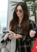 Megan Fox is all smiles as she flies out after filming 'Big Gold Brick' in Toronto, Canada