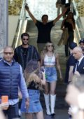 Miley Cyrus and Liam Hemsworth greet fans as they leave the Mandarin Oriental Hotel in Barcelona, Spain