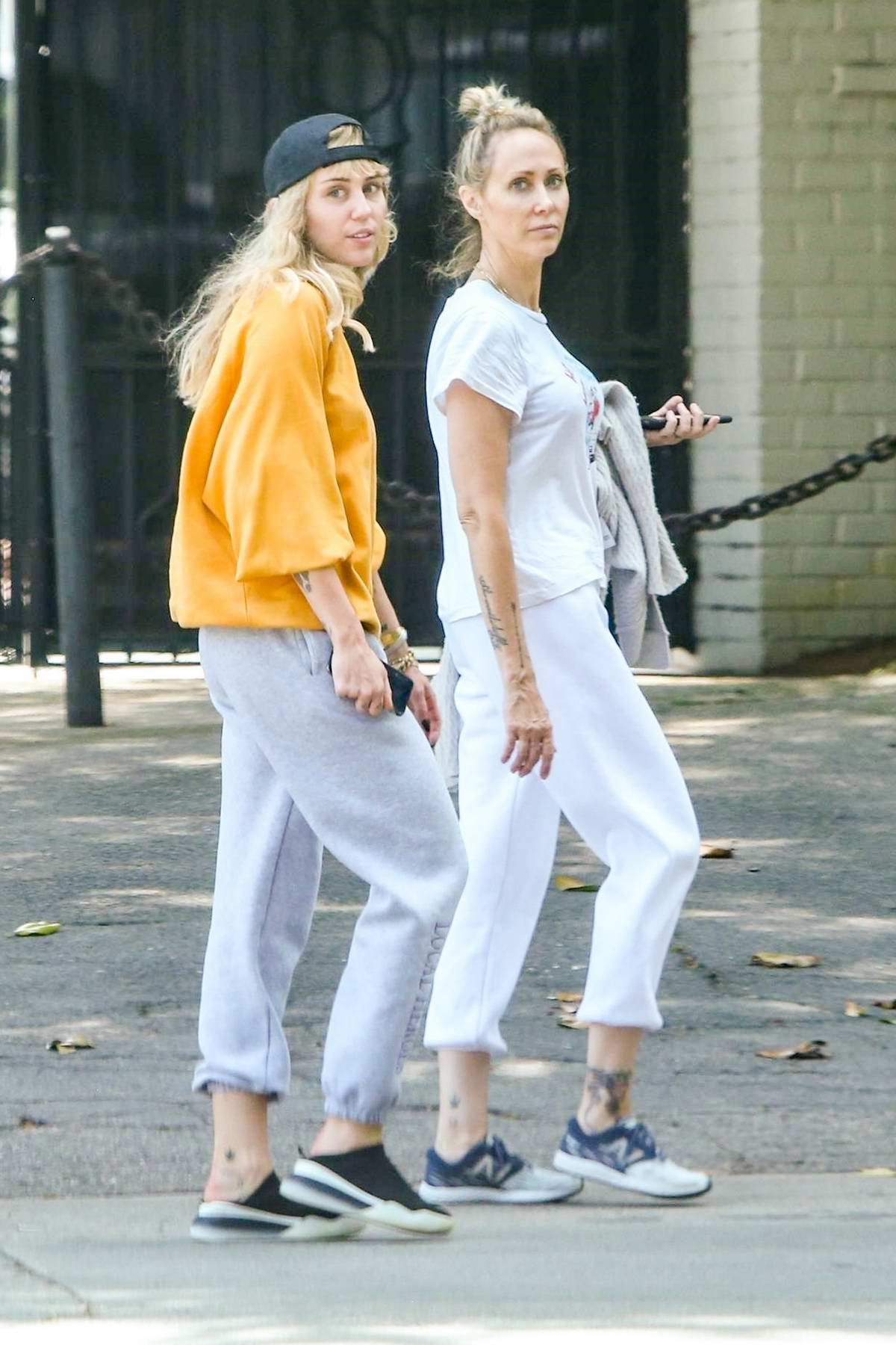 Miley Cyrus steps out for a walk with her mom Tish in Los Angeles