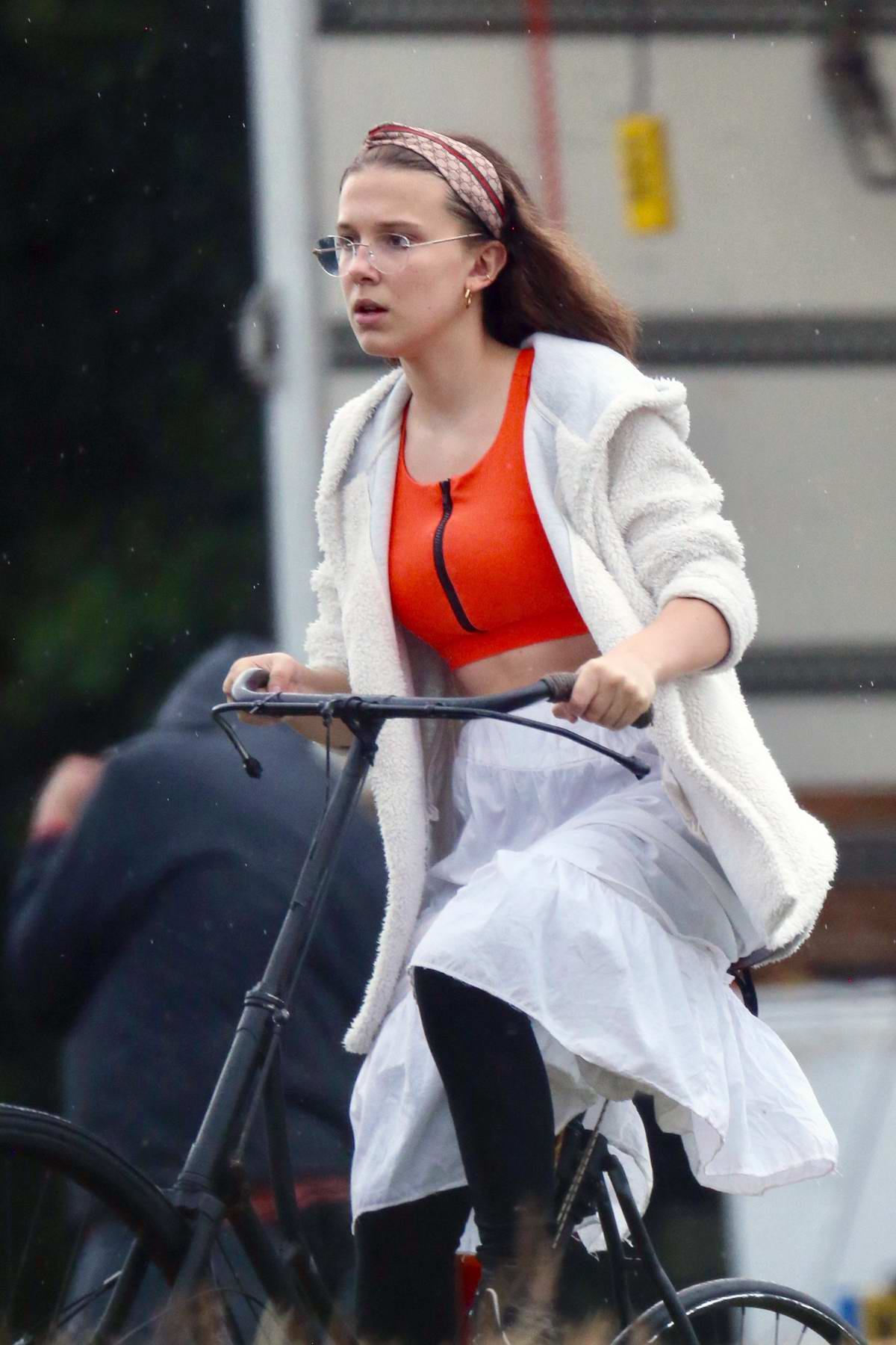 Millie Bobby Brown rides a bicycle on the sets of her new movie 'Enola Holmes' in Buckinghamshire, UK