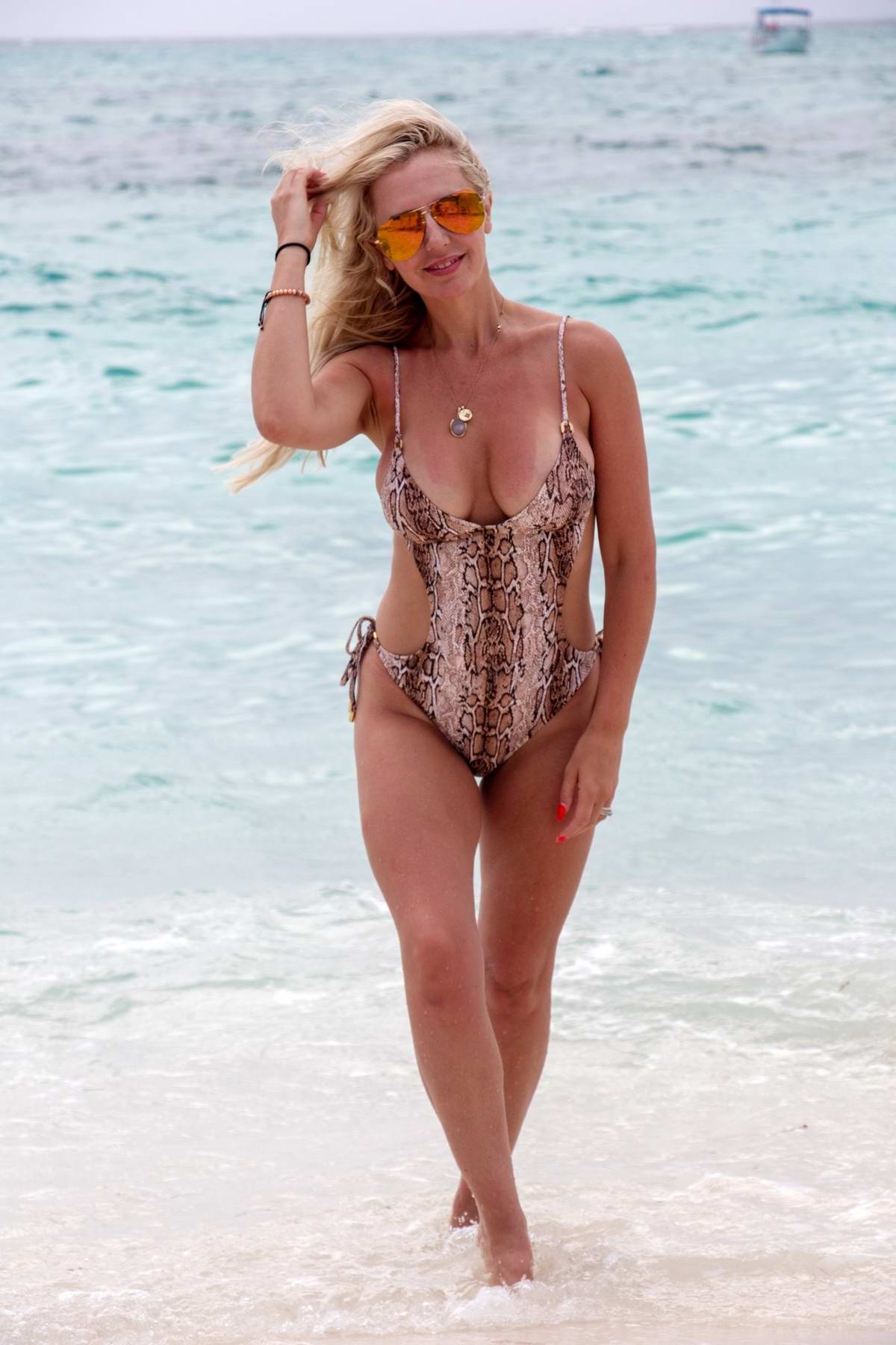 Naomi Isted enjoys the beaches in a swimsuit in Turks and Caicos