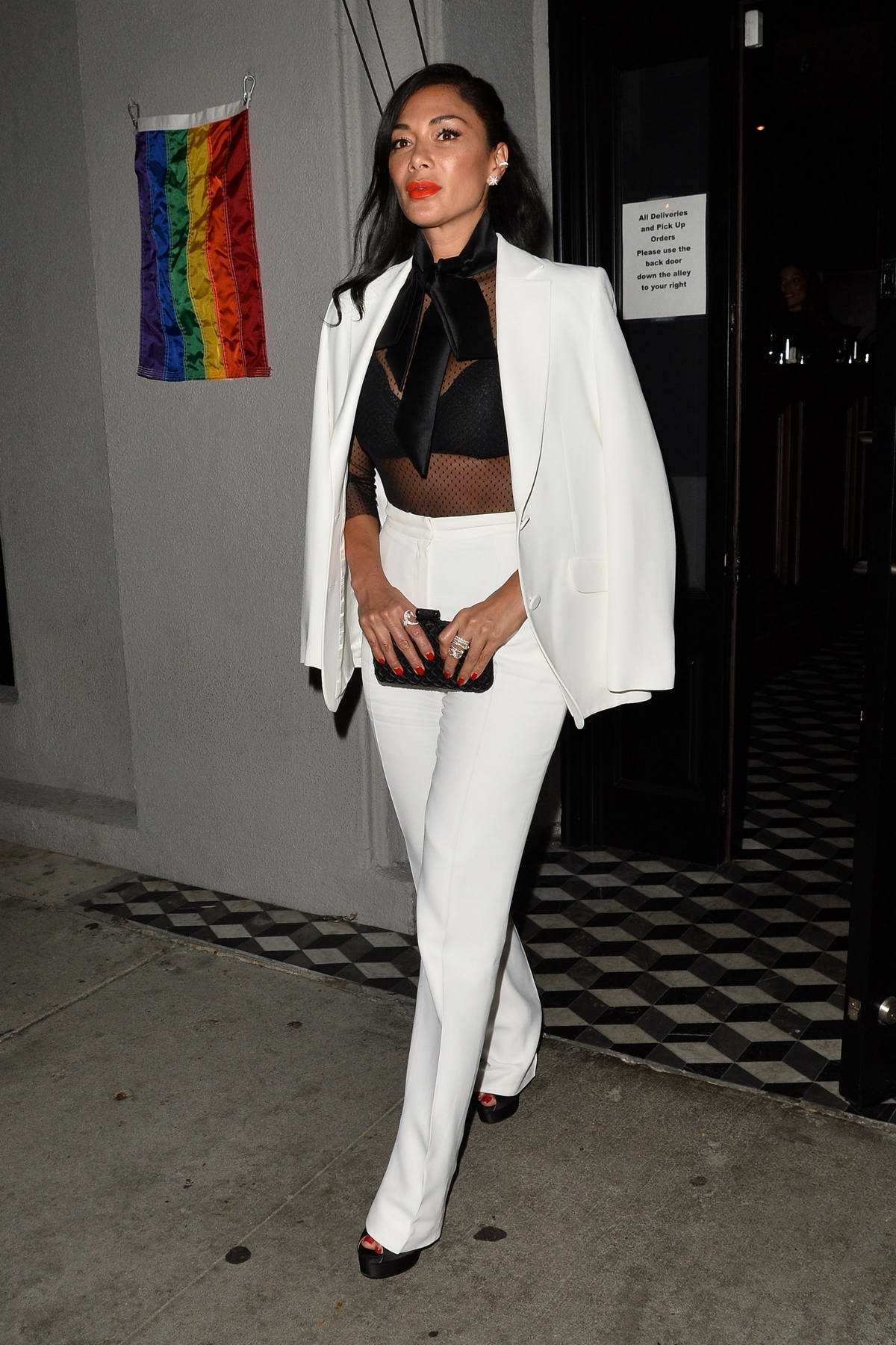 Nicole Scherzinger dons a white suit as she grabs dinner at Craig's in West Hollywood, Los Angeles