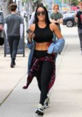 Nikki Bella sports a cropped black tank top and leggings while out running errands in Studio City, Los Angeles