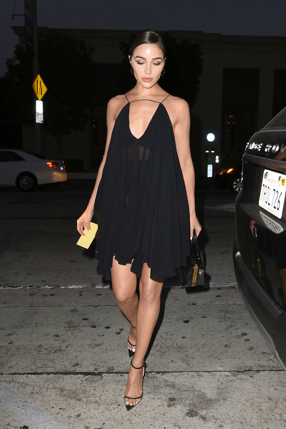 Olivia Culpo looks stunning in sheer black dress as she arrives for dinner at Catch restaurant in Los Angeles