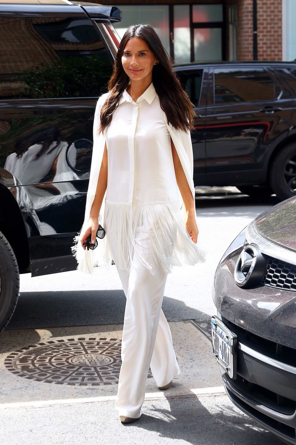 Olivia Munn is all smiles as she rocks an all-white ensemble while out in New York City