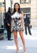 Olivia Munn looks great in a patterned black and white mini dress while out promoting her new TV series 'The Rook' in New York City