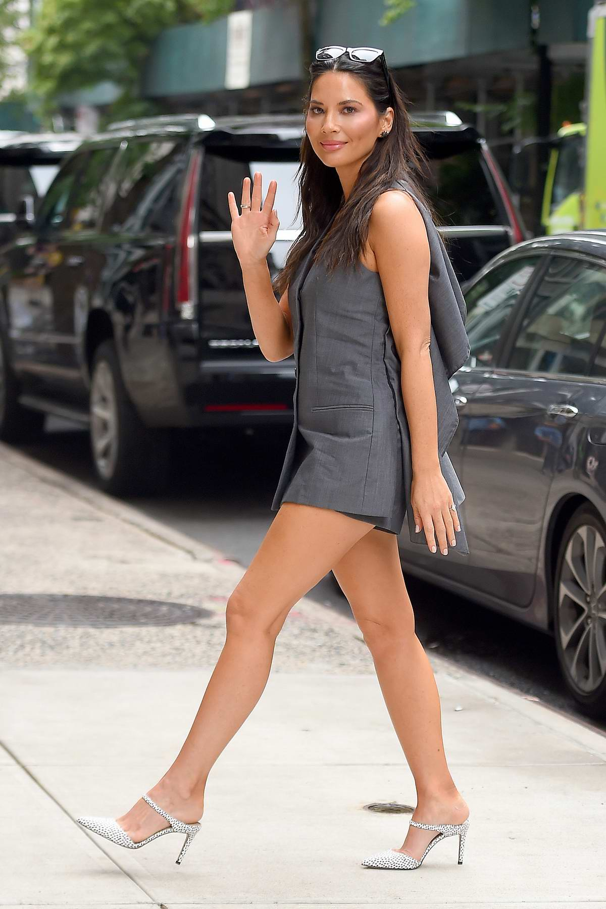 Olivia Munn looks stunning in a short grey outfit as she heads out in New York City