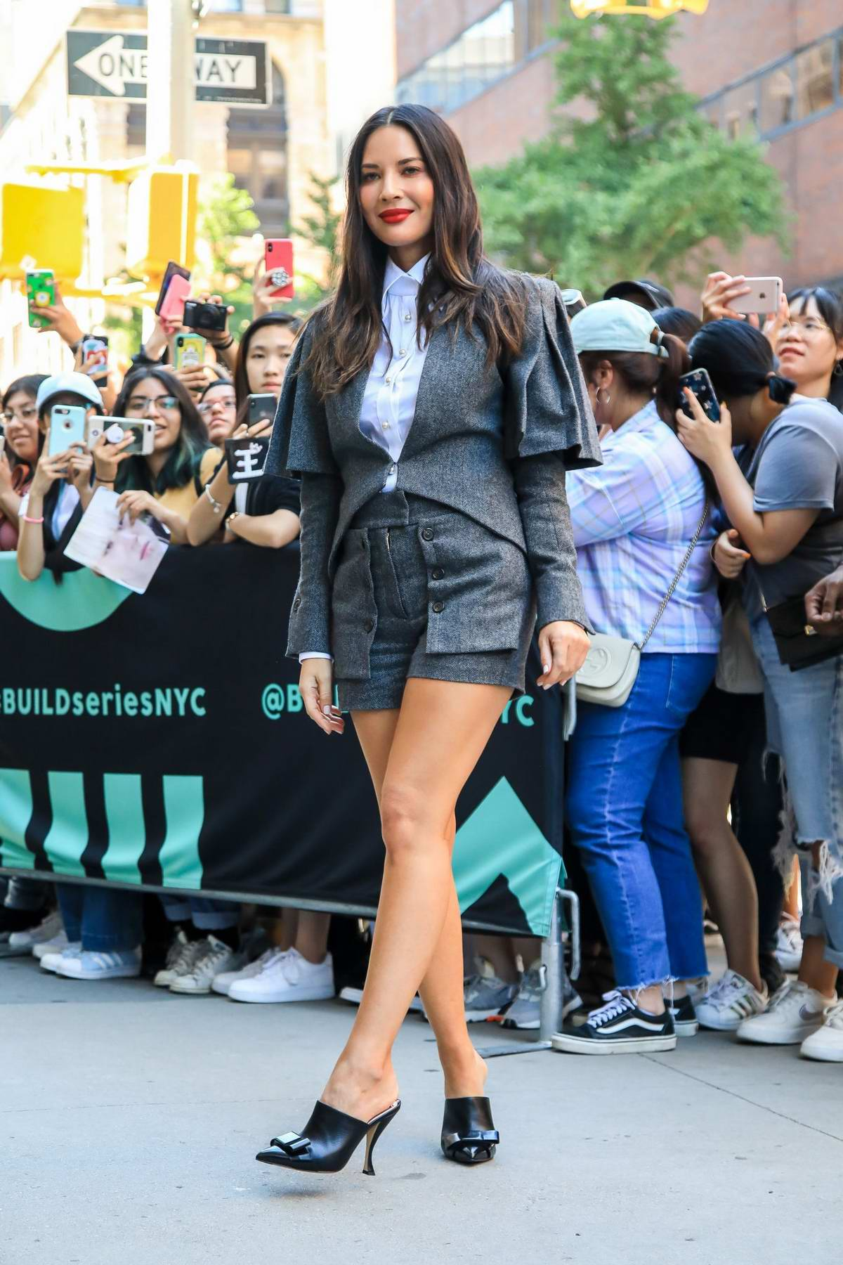 Olivia Munn sports a grey short suit while visiting Build Series to promote her new show 'The Rook' at Build Studio in New York City
