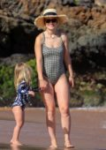 Olivia Wilde dons a checkered swimsuit while enjoying a beach day with her kids in Hawaii