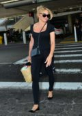 Pamela Anderson dons all-black as she touches down at LAX in Los Angeles