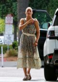 Paula Patton spotted in a floral summer dress while she stops to fill her Range Rover at a gas station in Malibu, California