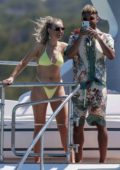 Perrie Edwards wears a yellow bikini while enjoying a day on a yacht with Alex Oxlade-Chamberlain in Ibiza, Spain