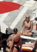 Pixie Lott relaxes by the pool in a polka dot swimsuit in Ibiza, Spain