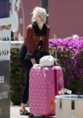 Pixie Lott spotted in a patterned mini jacket and Moschino flip flops while carting her pink suitcase in Ibiza, Spain